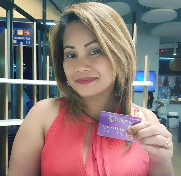 Migrant worker holding her card | Neema Master card