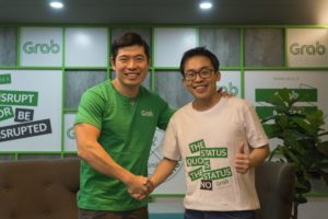 Grab CEO and co-founder Anthony Tan (left), together with Albert Lucius, CEO of Kudo (right) upon entering an agreement for Grab to acquire Kudo