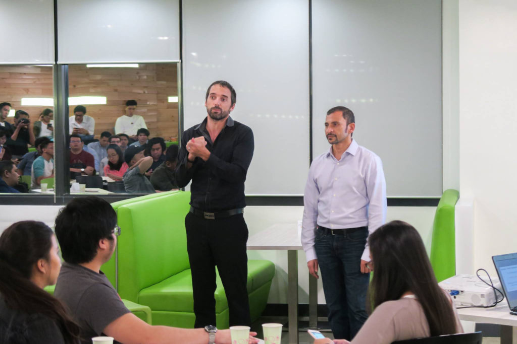 Sprout Solutions CEO Patrick Gentry (standing left) and engageSpark CEO Ravi Agarwal.