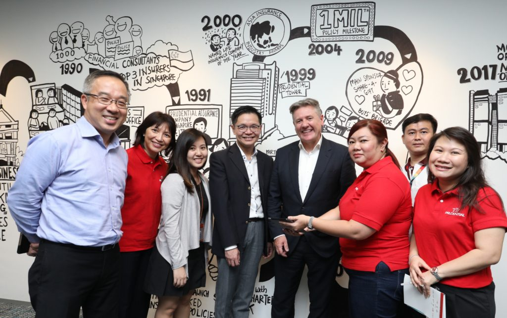 Prudential employees explore SkillsFuture courses together with Wilf Blackburn, CEO, Prudential Singapore and Ng Cher Pong, CEO, SkillsFuture Singapore