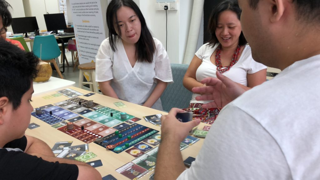 cryptocurrency singapore board game kickster playing